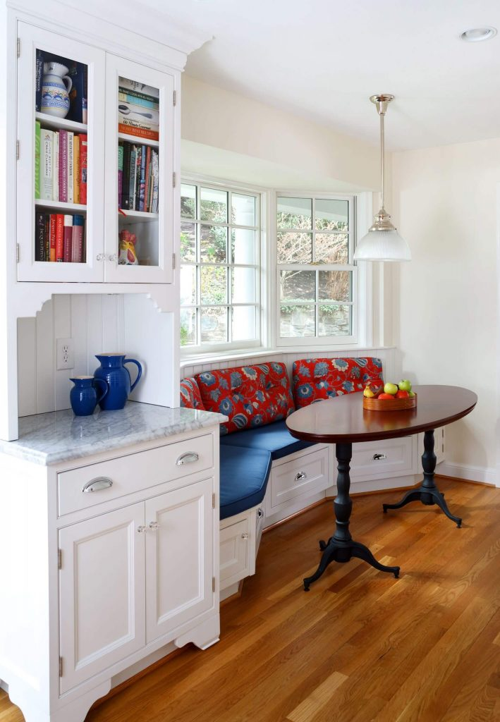 A 9 foot long banquette snakes under the bay window of this Washington, D.C., kitchen designed by Ahmann