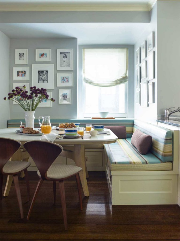 A combination of Benjamin Moore paints — Green Tint for the banquette and Silver Marlin for the walls — creates a soothing palette in this kitchen on Manhattan's Upper East Side