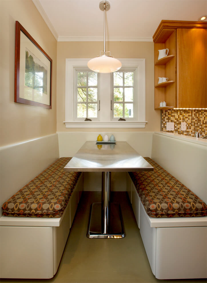 A custom built banquette in Boston has retro appeal with its chrome table and patterned fabric bench seats.