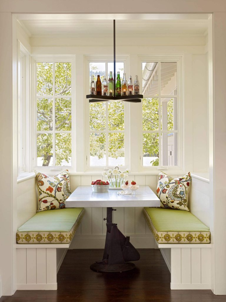 A custom chandelier made from old glass soda bottles makes a fun statement in this Calistoga, California, farmhouse kitchen