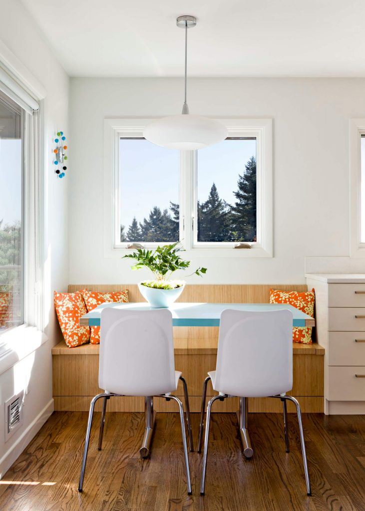 Blue and orange are the accent colors in this '50s remodeled kitchen area in Portland, Oregon