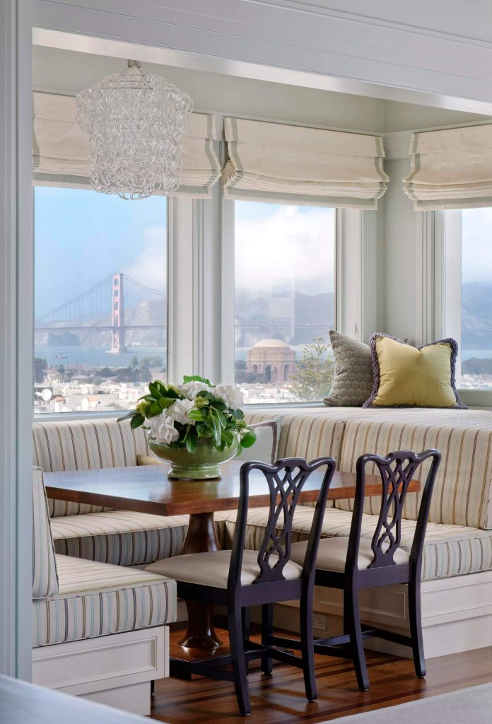 Brentano Fabrics' Festive Stripe fabric covers the banquette of this San Francisco kitchen nook with incredible views of the Golden Gate Bridge.