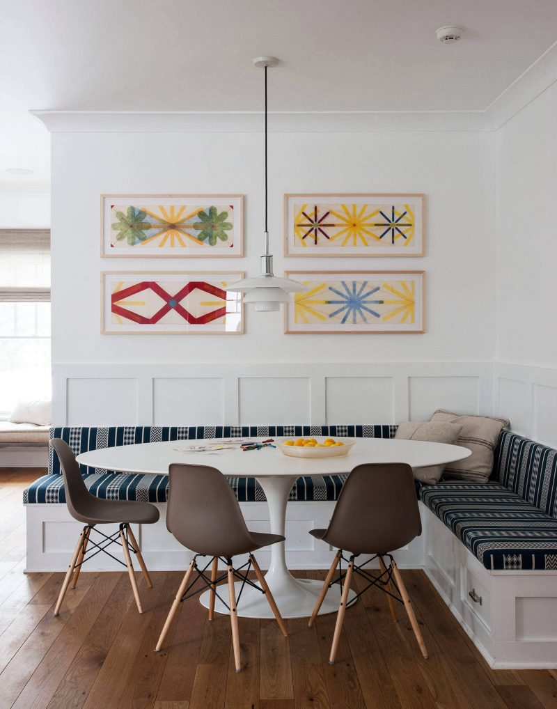 Colorful artwork found at Kenise Barnes Fine Art blends well with the modern furnishings of this kitchen area in Auckland, New Zealand