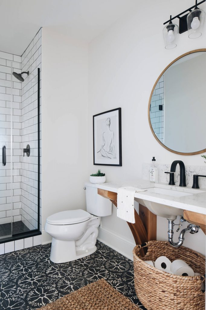 Country subway tile black floor alcove shower photo in Chicago with open cabinets, white walls, an undermount sink, a hinged shower door and white countertops