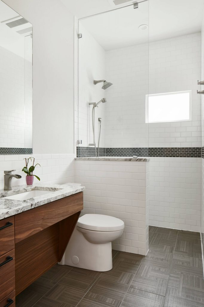Example of a mid sized transitional white tile and subway tile gray floor bathroom design