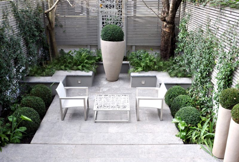 Example of a small minimalist stone patio container garden design in London