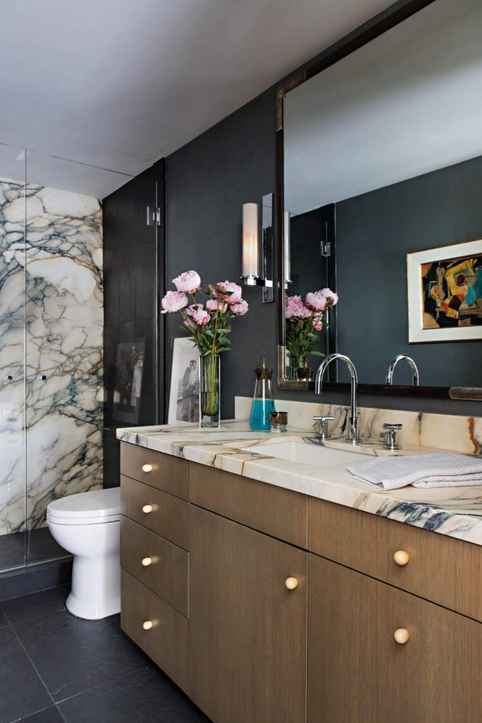 Example of a trendy black floor bathroom design in Orange County with flat panel cabinets, medium tone wood cabinets, an undermount sink and beige countertops (2)