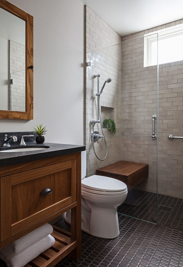 Example of a trendy black floor bathroom design in Orange County with flat panel cabinets, medium tone wood cabinets, an undermount sink and beige countertops