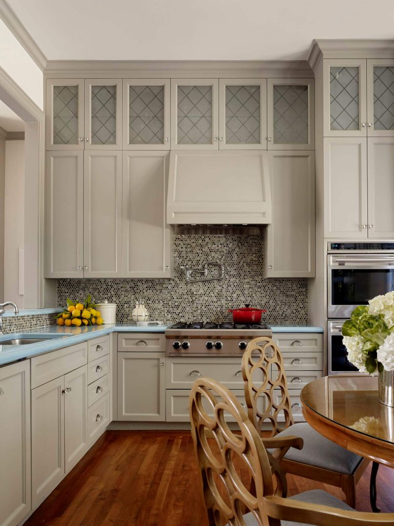 Example of a trendy kitchen design in San Francisco with mosaic tile backsplash, stainless steel appliances and turquoise countertops