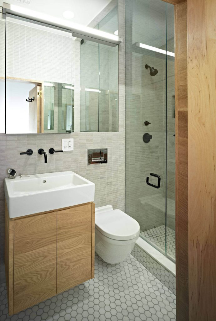 Inspiration for a contemporary bathroom remodel in New York with an integrated sink.