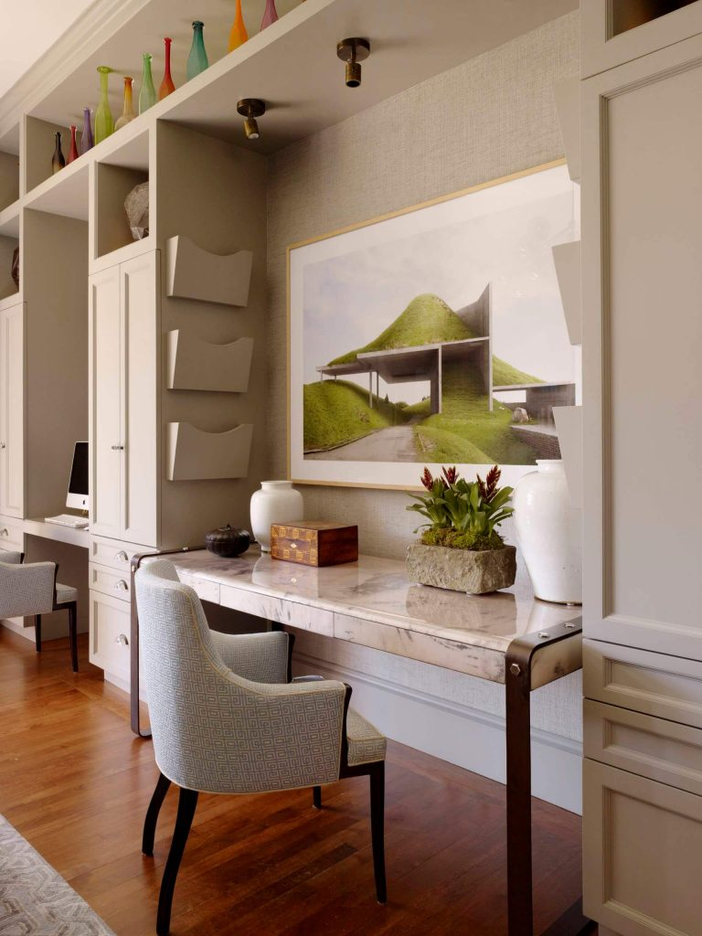 Inspiration for a contemporary medium tone wood floor home office remodel in San Francisco with beige walls