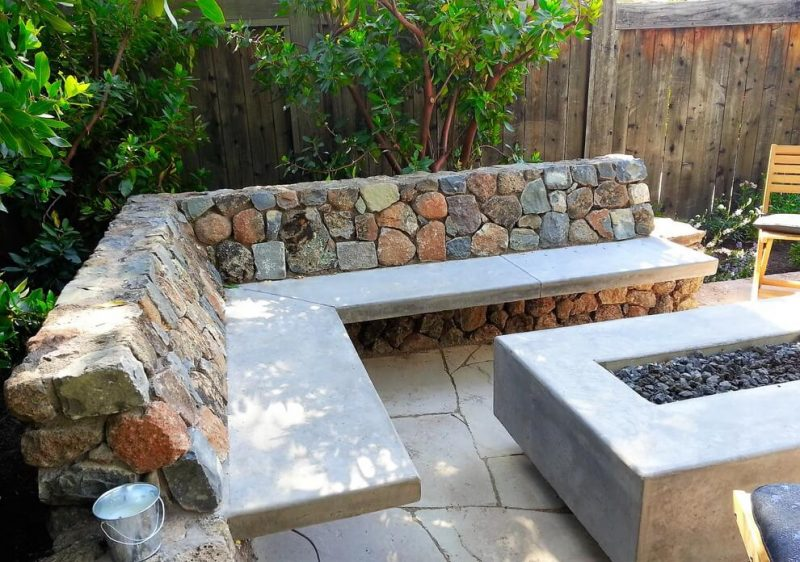 Inspiration for a small craftsman backyard stone patio remodel in San Francisco with a fire pit and no cover
