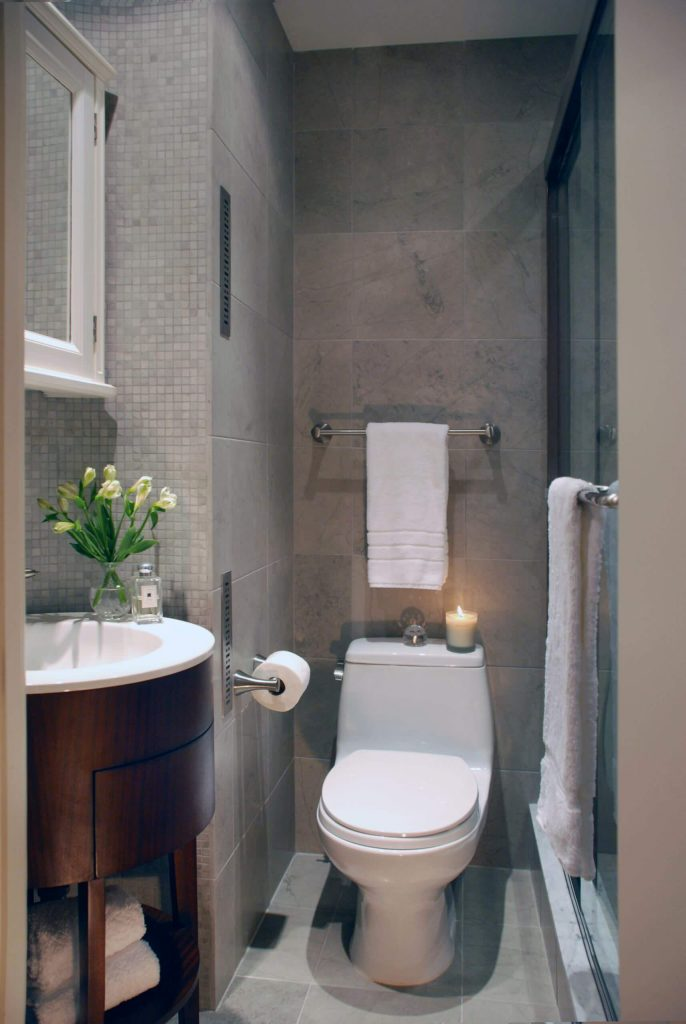 Inspiration for a transitional mosaic tile bathroom remodel in New York with a console sink.