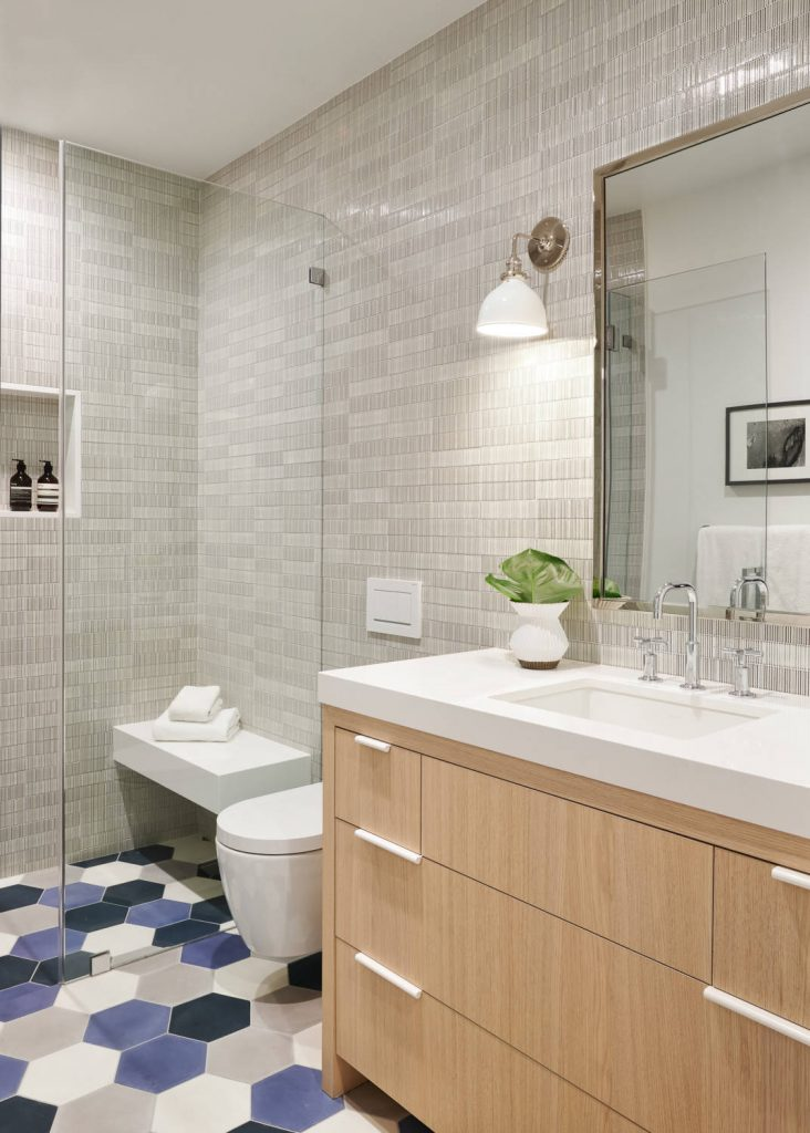 Large transitional kids ceramic tile and gray tile cement tile floor and blue floor walk in shower photo in San Francisco with flat panel cabinets