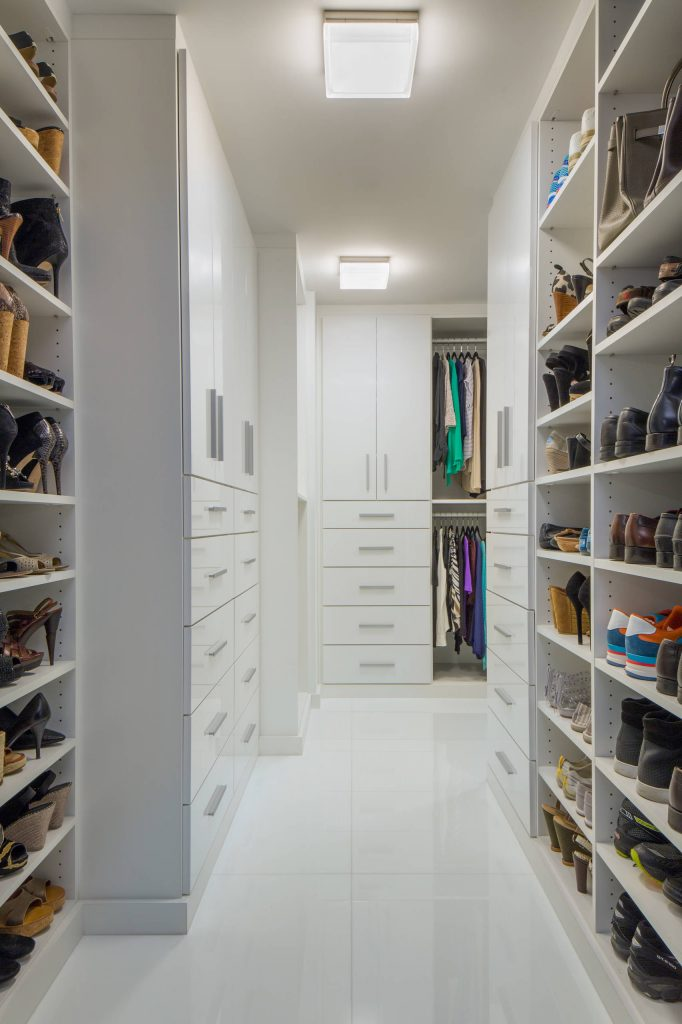 Most popular closet (9) This all-white closet shows us how lots of shelves and plenty of drawers and cabinets make for a slick and organized closet space. No nook or cranny goes to waste.