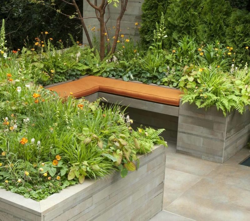 Sleek recycled sandstone by artisan Italian stonemasons gives a contemporary feel to the concept of an artisan garden