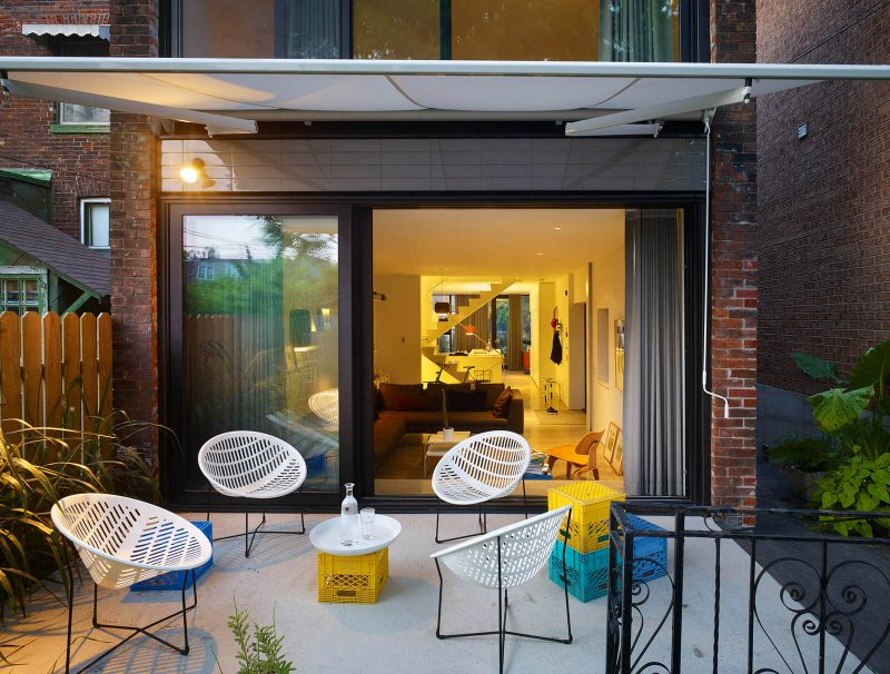 Small trendy backyard concrete patio photo in Toronto with an awning
