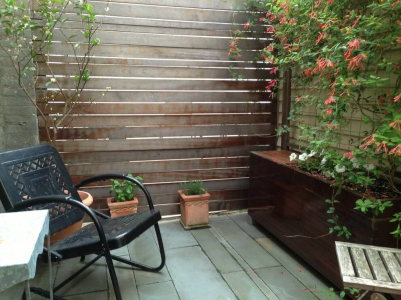 Small trendy backyard stone patio container garden photo in Baltimore with no cover