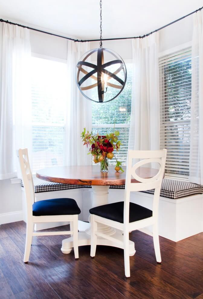 The circular pendant from Shades of Light adds sculptural interest to this Austin, Texas, breakfast area