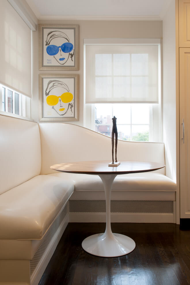 The smooth curves of this custom banquette make an elegant statement in this New York City kitchen