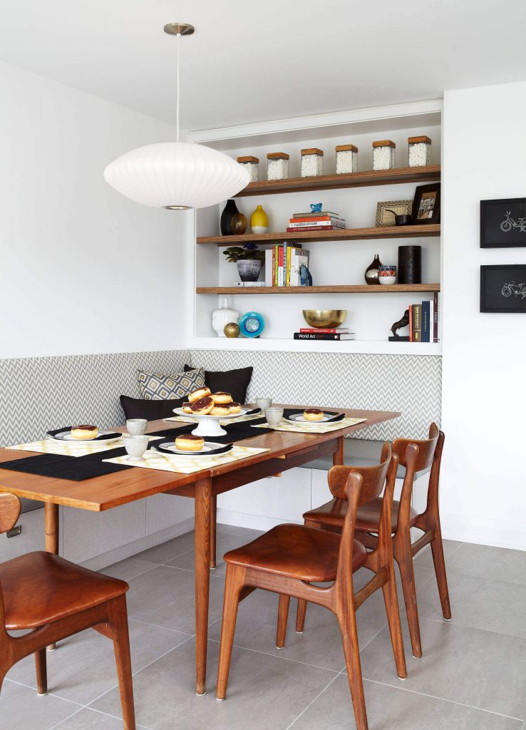 The style makers at Services Rendered Interior Design used a vintage table and chairs to complete this Toronto kitchen eating area