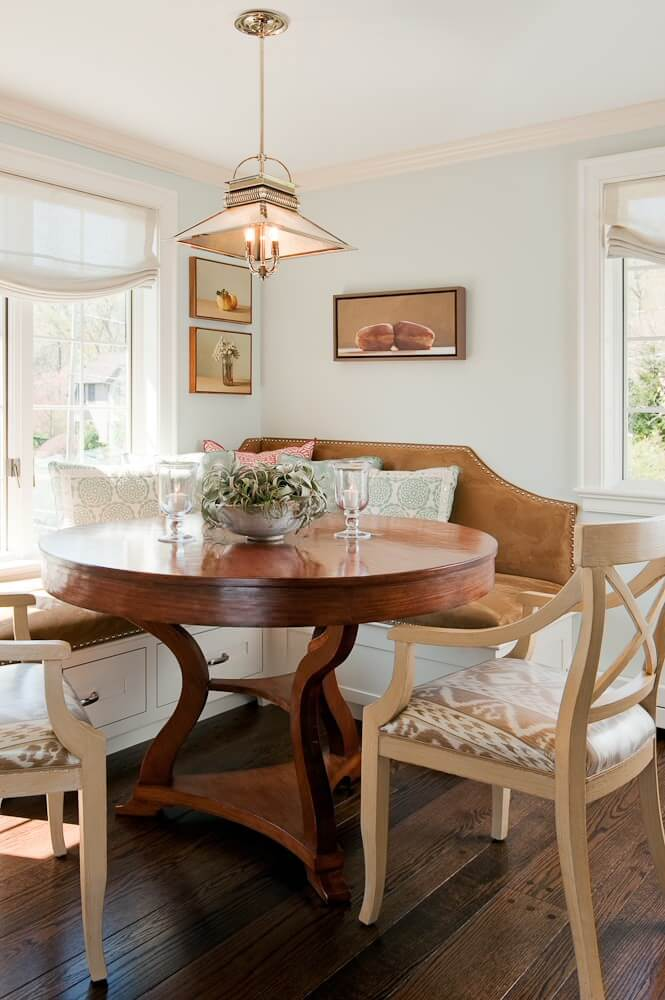 This Boston breakfast nook, designed by Su Casa Designs, includes a custom leather banquette with chrome nailheads
