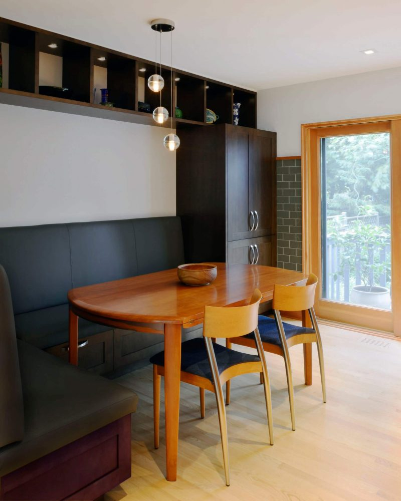 This contemporary Ottawa, Ontario, kitchen banquette created by Design First Interiors features a Bocci suspension lamp