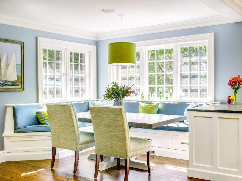 This sunny dining nook invites you in with its light blue, green, and cream hues