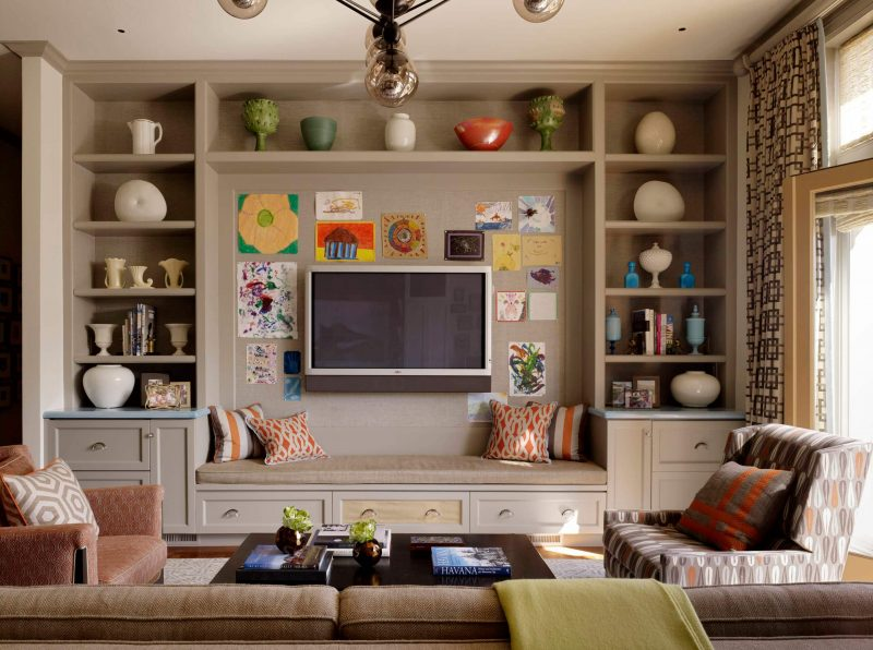 Transitional family room photo in San Francisco with beige walls and a wall mounted tv