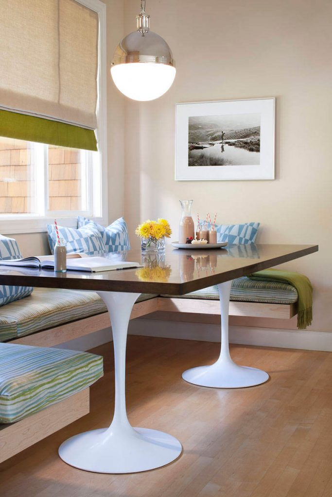Two white Knoll bases were topped with a custom wood table to create this bright breakfast nook in San Francisco