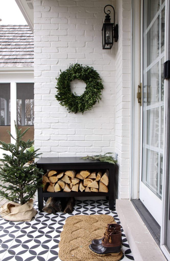 A door that can handle a wreath (like these glass sliders), try placing the wreath to the side, like we see in this pretty, wintry tableau.