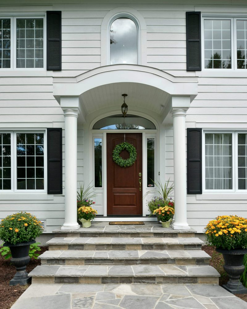 A plain green boxwood wreath makes the transition from fall to winter.
