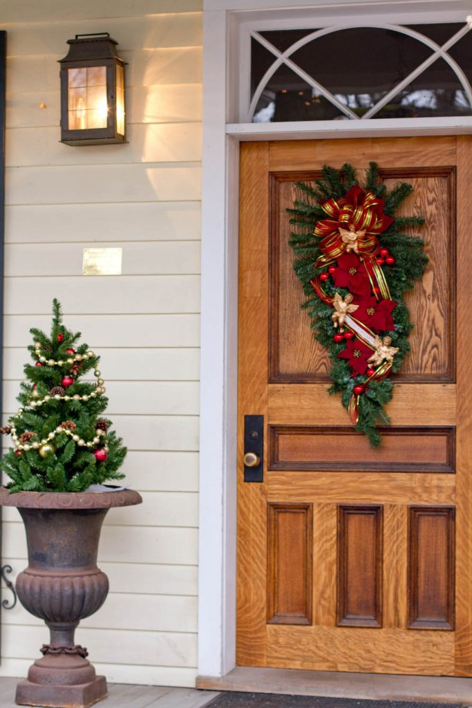 Decorating small evergreens in outdoor planters like Christmas trees is always fun.