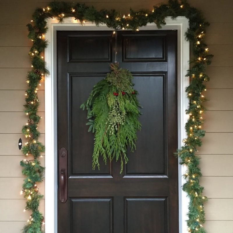 If a ring shaped wreath isn't for you, try a spray to help your home stand out.