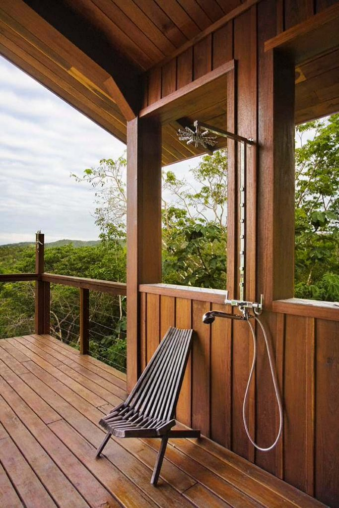 Outdoor shower with lush views of the tropical forest below