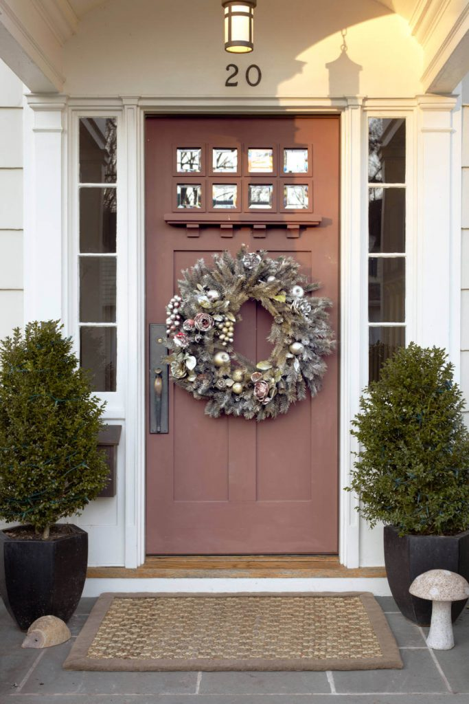 Silver and gold elements sparkle on this wreath.