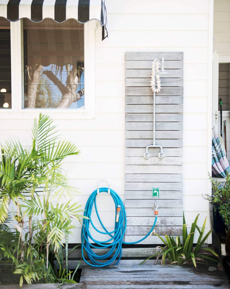 The shower outside this beachy house in Sydney designed by Jason Grant
