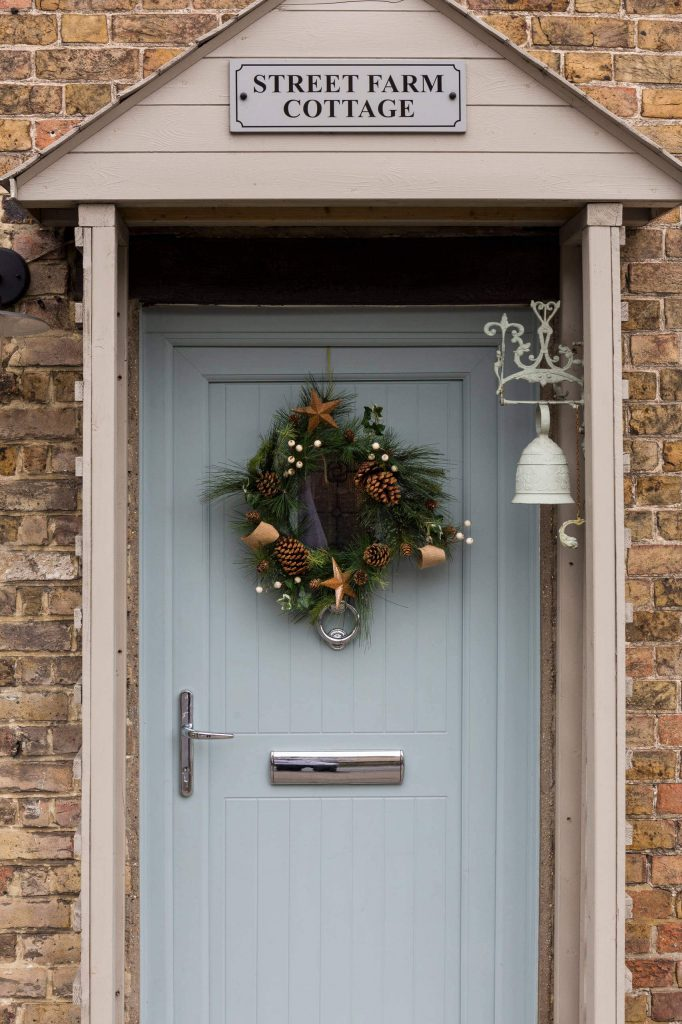 This beautiful wreath is just the right fit for this charming English cottage.