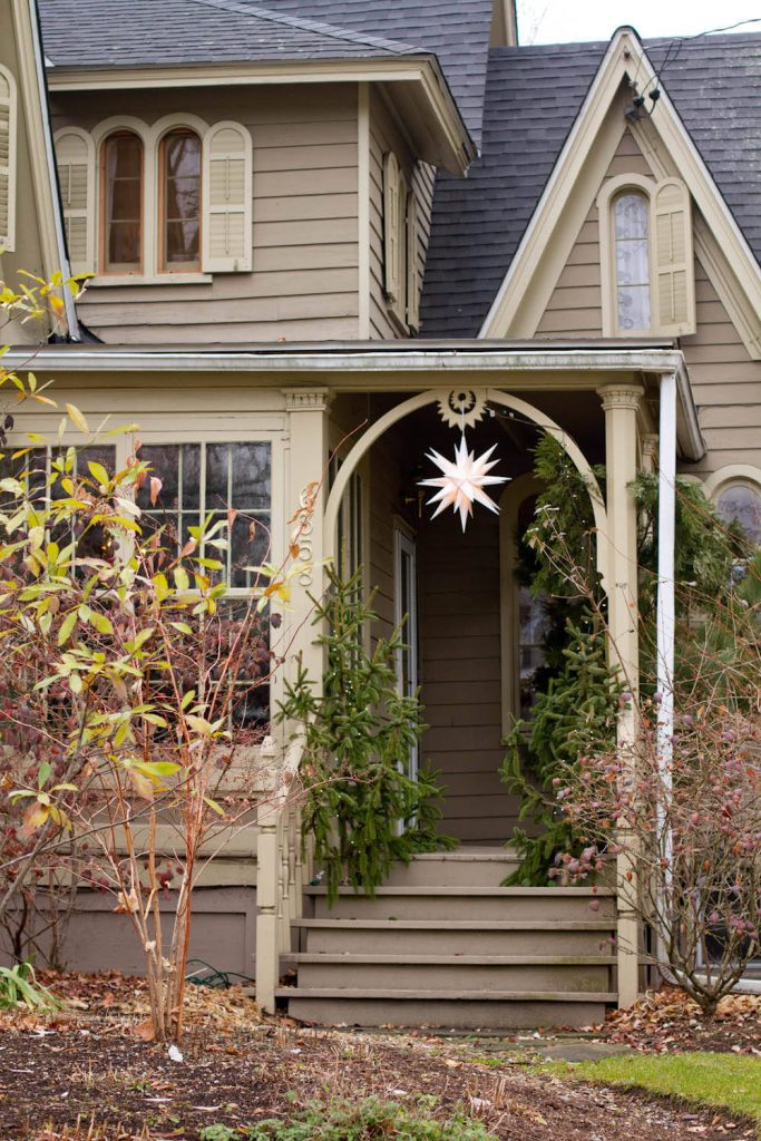 This door isn't visible from the street, so a beautiful star hanging from the porch marks the season instead.