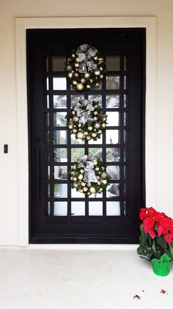 This large door is doing triple duty for the holidays.