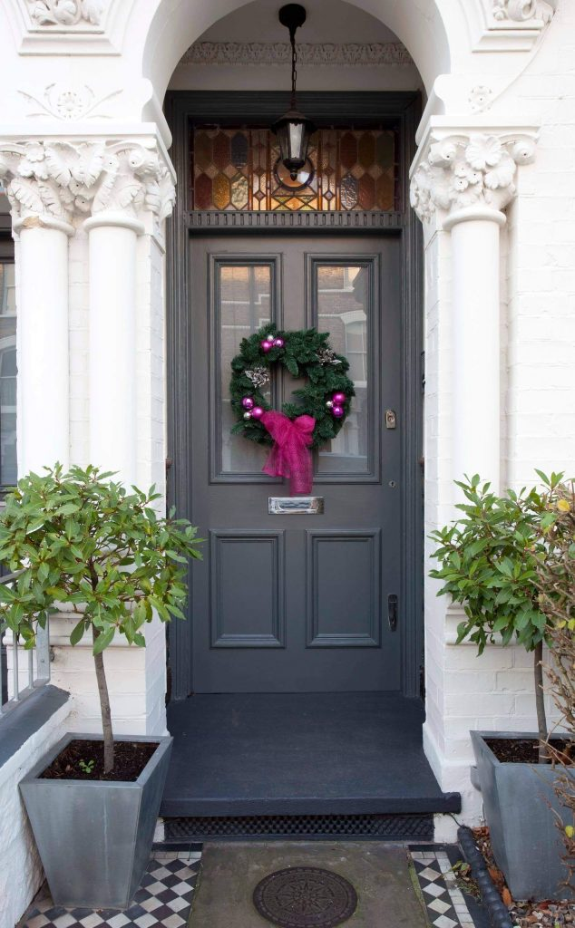 This wreath foreshadows the unexpected jewel toned holiday accents that await inside.
