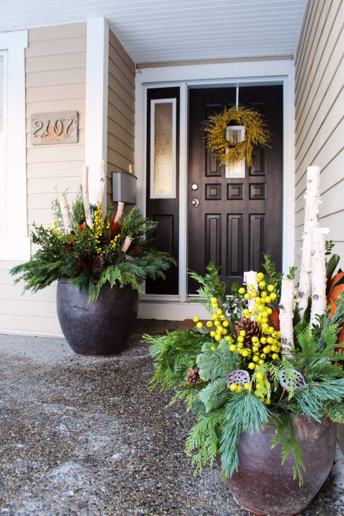 Unexpected chartreuse and yellow berries rev up this entry's decorations.